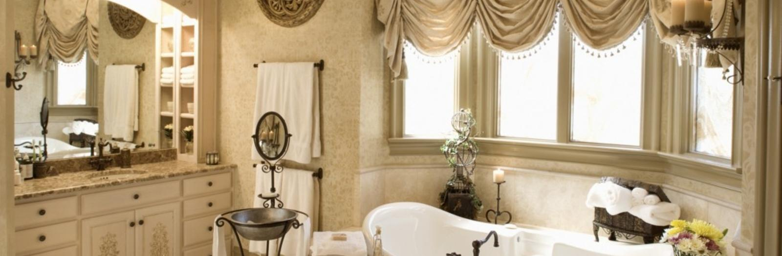 French Country Bathroom with oil rubbed bronze bathtub faucet