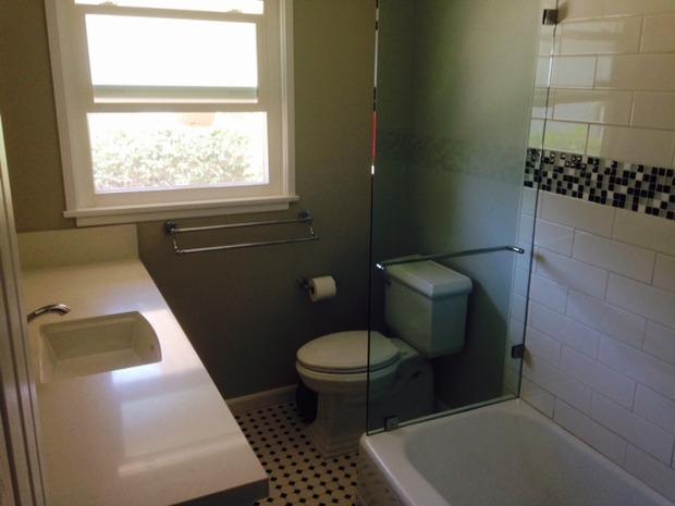 Tudor bathroom in santa barbara glass tub divider glass for Tudor bathroom design