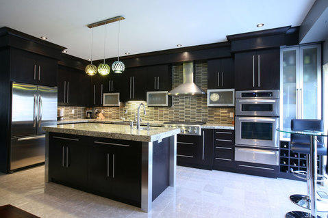 Modern Kitchen with varied color hanging pendants