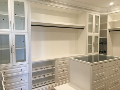 Traditional Closet with glass top accessorie closet island