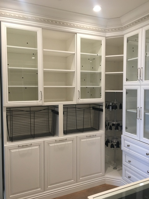 Traditional Closet with glass top accessorie island