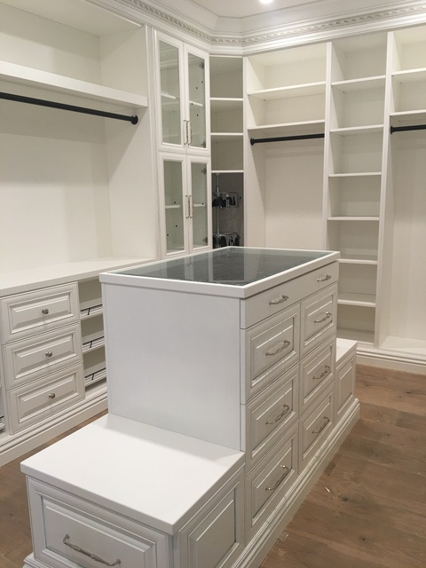 Traditional Closet with white built in closet organizers