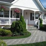 Victorian Home Exterior with gray stone paver pathway with decorative design