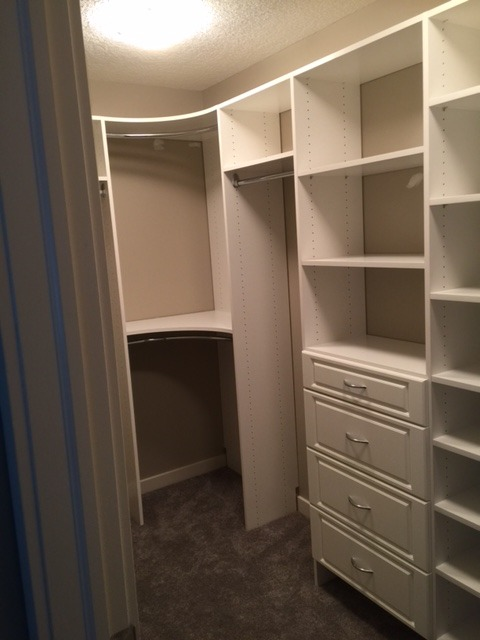Traditional Closet with white raised panel drawers