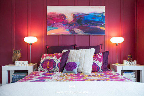 Eclectic Bedroom with pink and white pillows