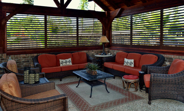Contemporary Patio with wrought iron coffee table