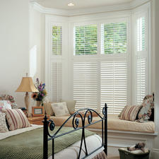 Casual / Comfortable Bedroom with white plantation shutters