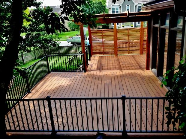 Transitional deck in kansas city trex decking large for Creative home designs llc