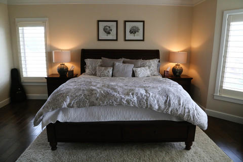Transitional Bedroom with dark wood wide plank floors