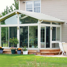Traditional Sunroom with sliding glass doors