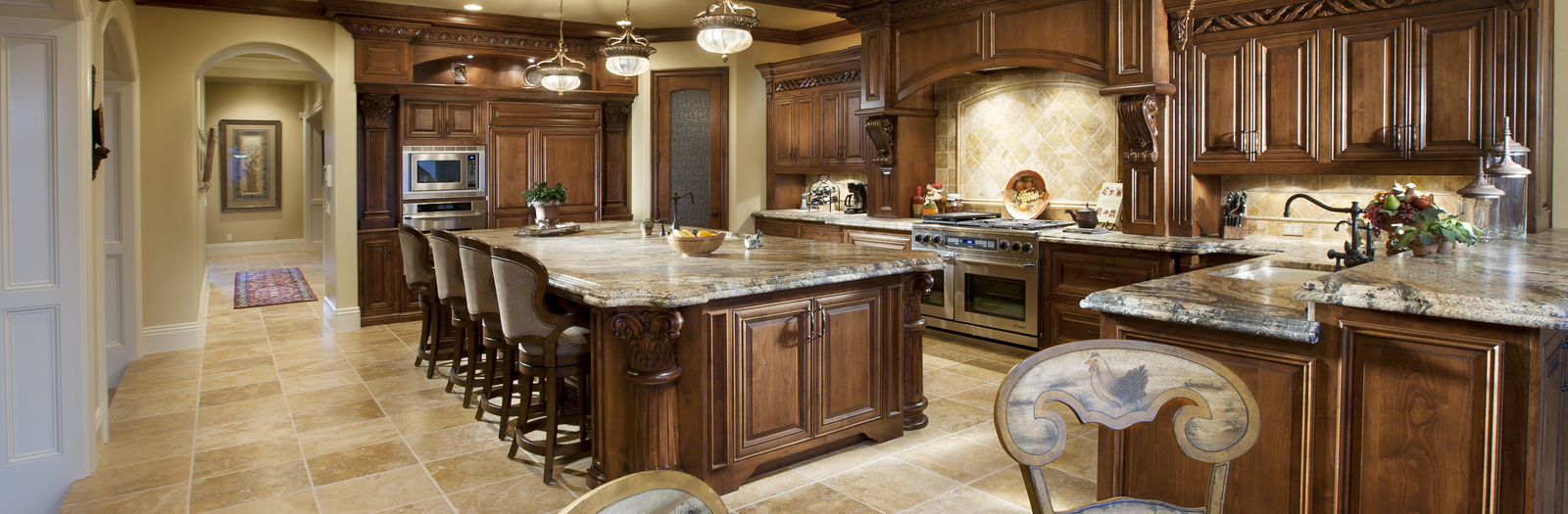 Tuscan Kitchen With Large Stainless Steel Appliance
