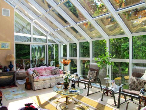 Eclectic Sunroom with glass coffee table