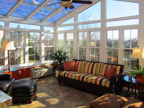 Transitional Sunroom with striped cushions