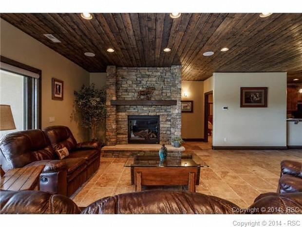 Rustic Basement In Colorado Springs Rustic Basement Stacked Stone Fireplace By Peak Side Stone