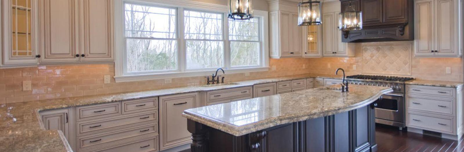 Traditional Kitchen with traditional style kitchen with off white cabinetry and a large island
