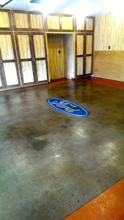 Eclectic Garage with acid stained garage floor