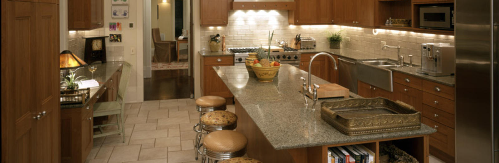 Traditional Kitchen with long kitchen counter with barstool seating