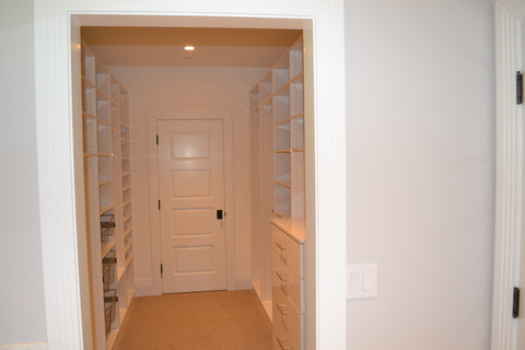 Traditional Closet with built in closet organizer