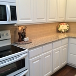 Transitional Kitchen with tan subway tile backsplash