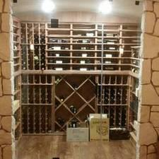 Modern Wine Cellar with frameless glass door