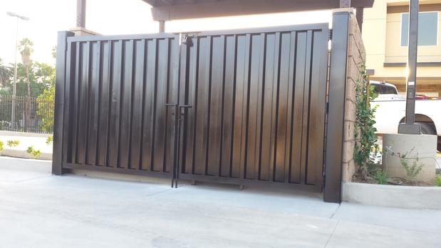 Contemporary Home Exterior In Riverside Black Metal Gate