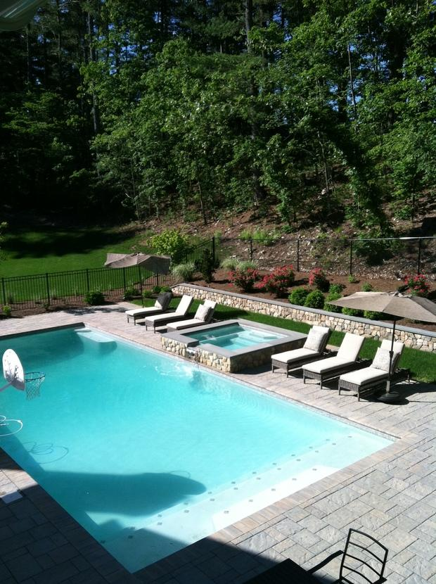 Contemporary Pool With Raised Hot Tub With Stone Exterior