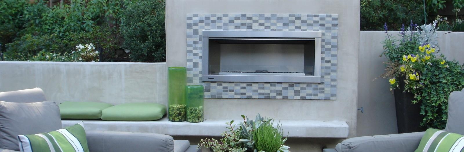Contemporary Fireplace with gray upholstered outdoor chair