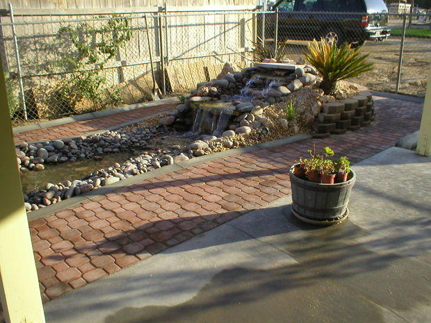 Traditional patio in visalia rock waterfall water for Landscaping rocks visalia ca