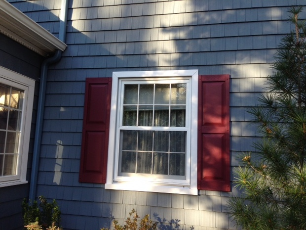 Arts crafts home exterior in north haven red painted window shutters white wood trim by for Arts and crafts exterior shutters