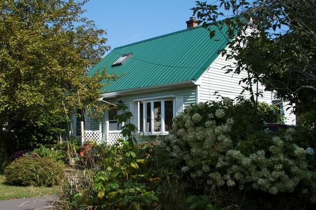 Cottage Home Exterior With Pale Mint Green Siding