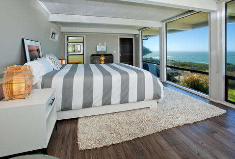 Modern Bedroom with wide plank wood floors