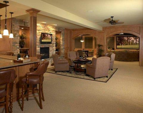 Traditional Basement with stacked stone fireplace surround