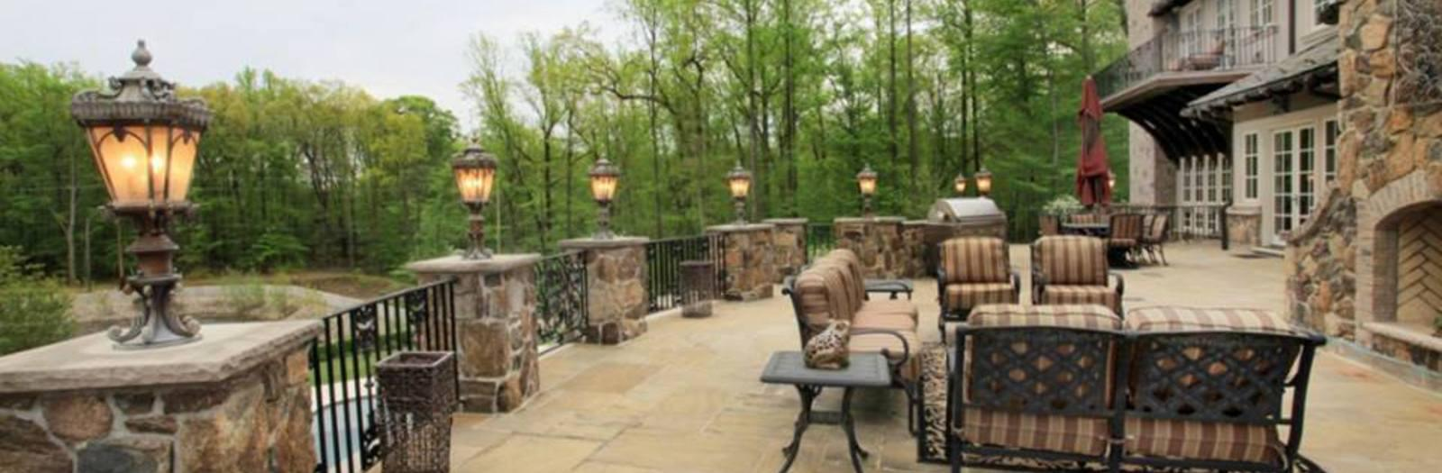 Traditional Deck with stone pillars with lanterns