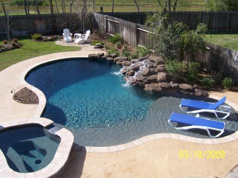 Transitional Pool with water fall into the pool