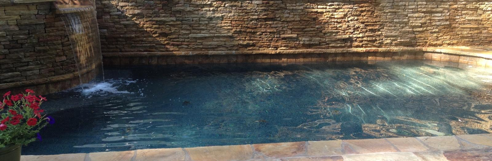 Mediterranean Pool with hot tub overflows into pool