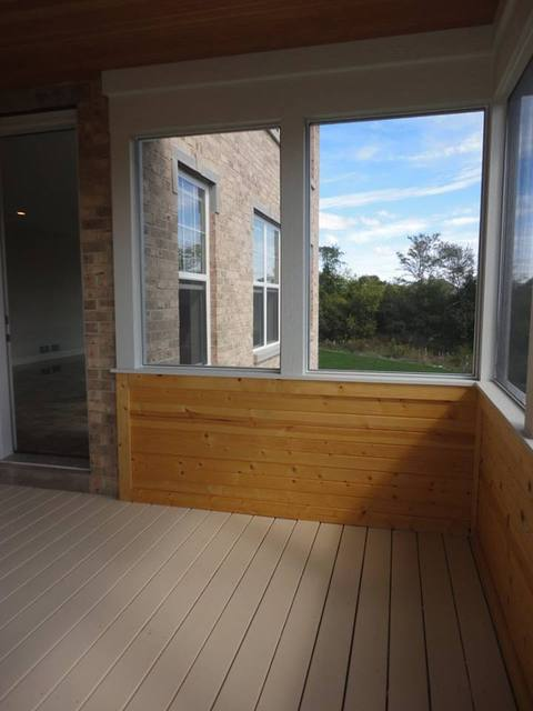 Transitional Sunroom with tan brick exterior