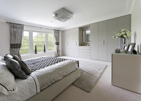 Modern Bedroom with grey flat front cabinetry