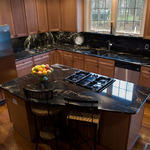 Contemporary Kitchen with black marbled granite counter
