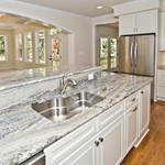 Transitional Kitchen with light granite counters