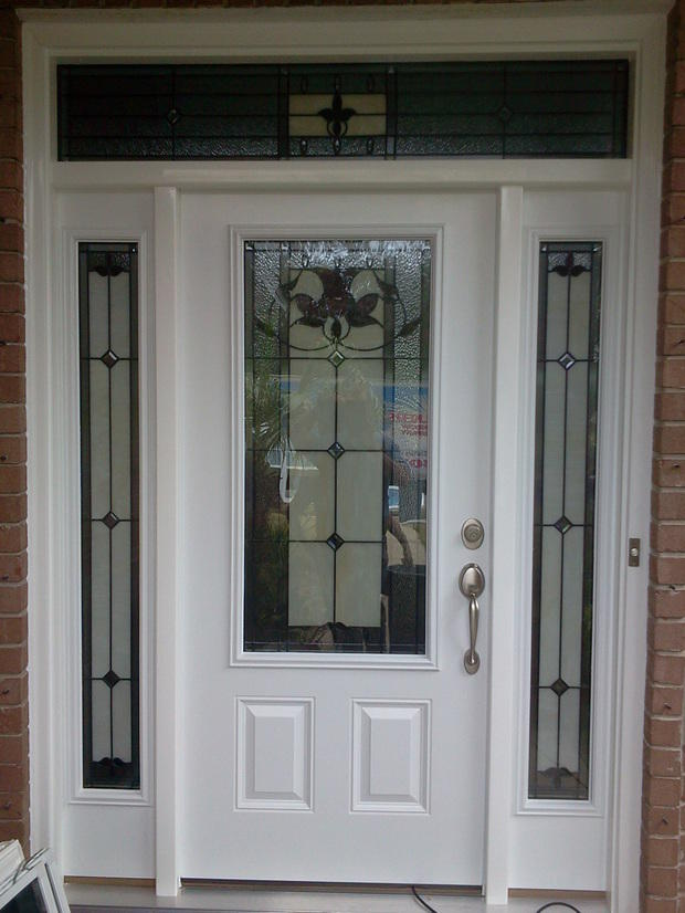 Traditional Home Exterior In Pensacola Decorative Glass Window