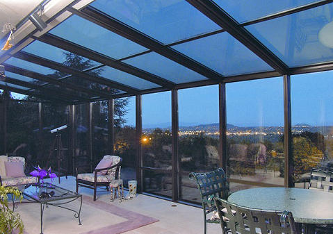 Modern Sunroom with glass top table