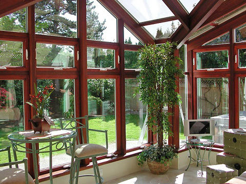 Modern Sunroom with cherry wood framing