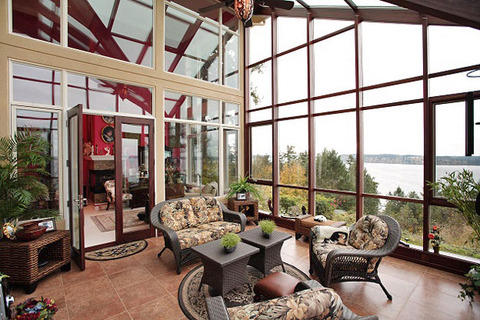Modern Sunroom with wicker furniture set