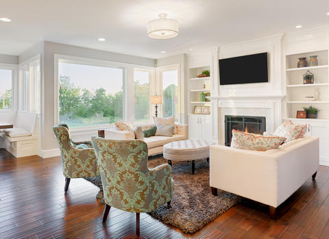 Transitional Family Room with upholstered wingback chairs