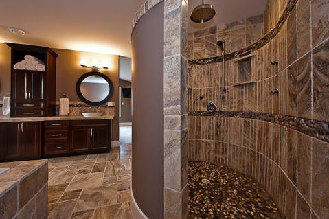 Traditional Bathroom with dark stained recessed panel cabinetry