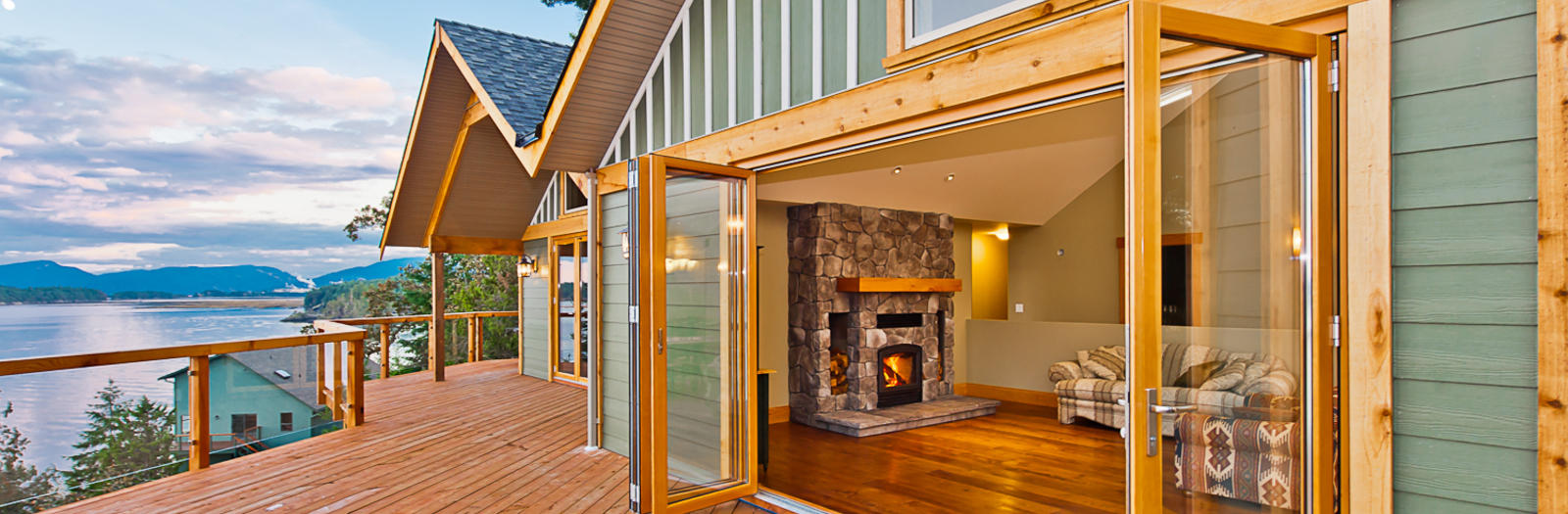 Lodge Home Exterior with glass paneled railing with natural wood trim