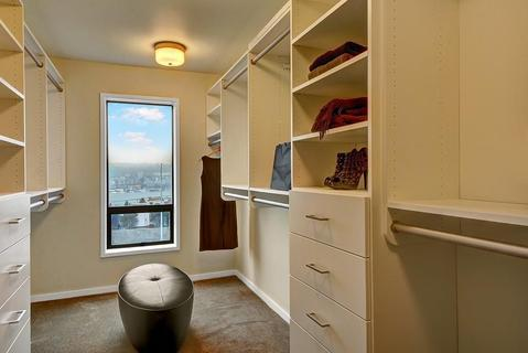 Traditional Closet with beige painted walls