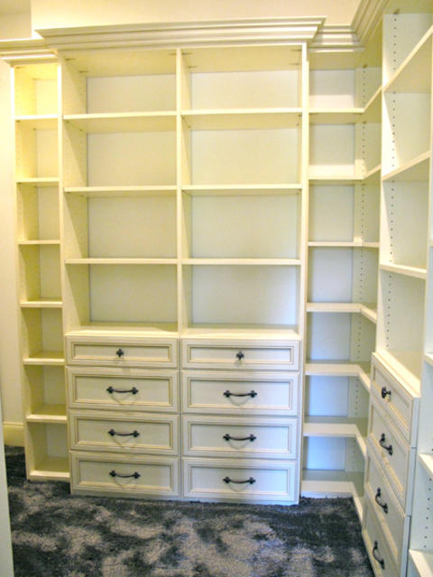 Traditional Closet with white crown molding