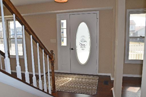 Transitional Entry with oval cut glass door insert
