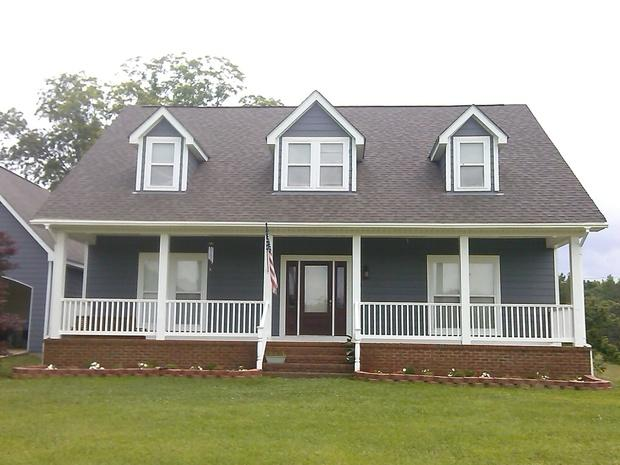 Cape cod home exterior in prattville white railing for Cape cod homes with front porches